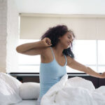 Beautiful Young African American Woman Waking Up In Bed